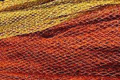 Fishnet rojo y amarillo Fotos de archivo