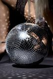 Fishnet stockings and disco ball Royalty Free Stock Images