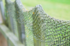FishNet on a wood fence stock photo