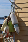 Fishnet Wooden and Styrofoam Floats hang to dry Stock Photo