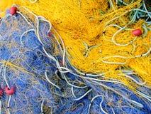 Fishnets azuis e amarelos Fotografia de Stock Royalty Free