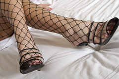 Fishnets on bed Stock Photos