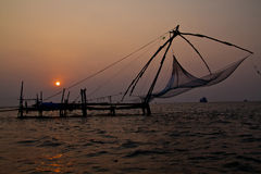 Fishnets in Cochin. India traditional fishing nets in sunset Stock Image