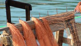 Fishnets Fishing Lines. The Fishnets Fishing Lines repaired by fisherman stock video