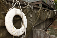 Fishnets and lifebuoy Stock Photography