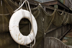 Fishnets and lifebuoy Royalty Free Stock Photo