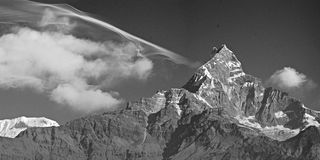 Fishtail mountain and Cloud. Macchapuchre Peak and Cloud, Nepal, Annapurna Trail royalty free stock photo
