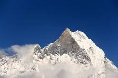 Fishtail peak just above the clouds. Annapurna base camp prey flags nepal Royalty Free Stock Photos