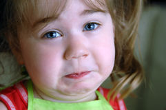 Fishy Smell. Little girl wrinkles her face up in a frown from something smelling aweful.  Image shows closeup of her face Stock Photo