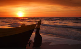 Fisihing boat at the sunset. Fishing boat looking into sunset, romantic view Royalty Free Stock Images