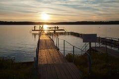 Fising bij zonsondergang Stock Afbeeldingen
