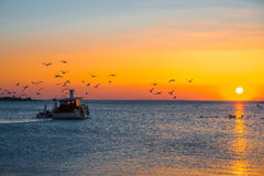 Fising boat on sunset Royalty Free Stock Photo