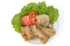 fisk grillade tomater royaltyfri foto