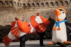 Fisk- och pingvinmaskering för karneval 2014 Arkivbilder