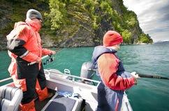 fiska för pojkar Arkivfoto