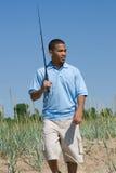 fiska gående man Arkivfoto