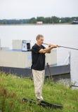 Fiska med snurr på kanalen i Tyskland Arkivfoto