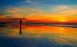 Fiska på solnedgången Royaltyfria Foton