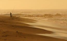 Fiska på soluppgången Arkivfoto
