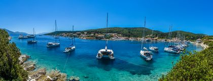 Fiskardo panoramic view of Kefalonia greece. The port of phiskardo in Kefalonia. A small port with ships and a must see destination for those who travel to Stock Photo