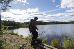 Fiskare och en sjö Fotografering för Bildbyråer