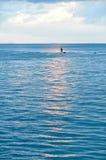 Fiskare och havet. Royaltyfria Foton