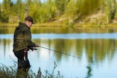 Fiskare och landskap Arkivbild