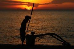 Fiskare och solnedgång Arkivfoton