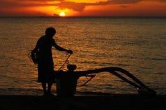 Fiskare och solnedgång Royaltyfri Bild