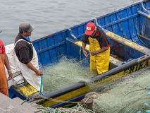 Fiskare på ett fartyg Royaltyfria Bilder