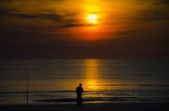 Fiskare på gryning Fotografering för Bildbyråer