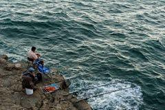 Fiskare på kusten, Cascais, Portugal Royaltyfri Bild