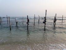 fiskare på poler Arkivfoto