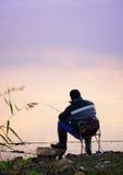 Fiskare på solnedgången Fotografering för Bildbyråer