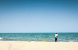 Fiskare på strand Royaltyfria Foton