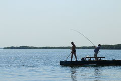 Fiskare på pir Royaltyfria Bilder