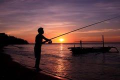 Fiskare på soluppgången Fotografering för Bildbyråer