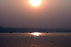 Fiskare Silhouette Fotografering för Bildbyråer