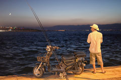 Fiskarejakt på natten Arkivbild