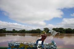 Fiskaren av framtiden göras av stål royaltyfria foton