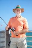 fiskarevänskapsmatchpensionär arkivbilder