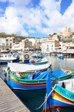 Fiskebåtar i den Mgarr hamnen, Gozo royaltyfri foto