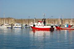 Fiskebåtar i porten Arkivfoto