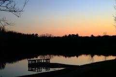 Fiskedock på solnedgången arkivfoto