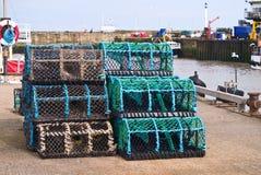 Fiskefiskkorgar på en hamn Royaltyfri Bild