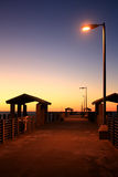 Fiskepir på soluppgång Arkivfoton