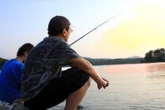 fiskesolnedgång royaltyfri fotografi