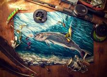 Fisketillbehör på tabellen arkivbild