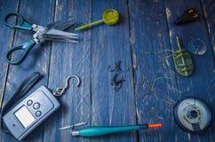 Fisketillbehören rotas lite varstans Utrymme i mitten Copyspace Arkivfoto