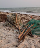 Fiskeutrustning som ligger på stranden Fotografering för Bildbyråer